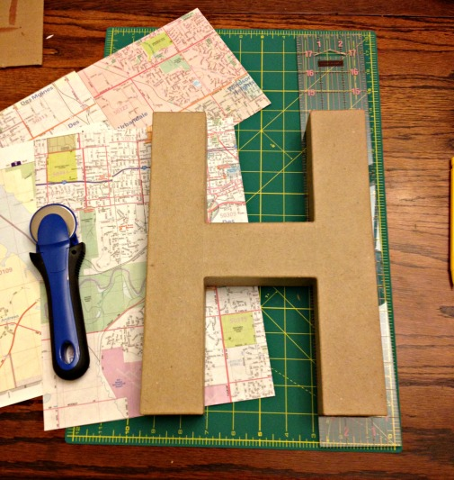 map covered letter supplies