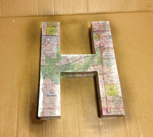 map covered letter spray gloss